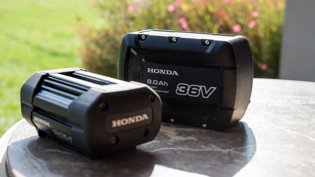 Close up Honda cordless batteries in garden location.