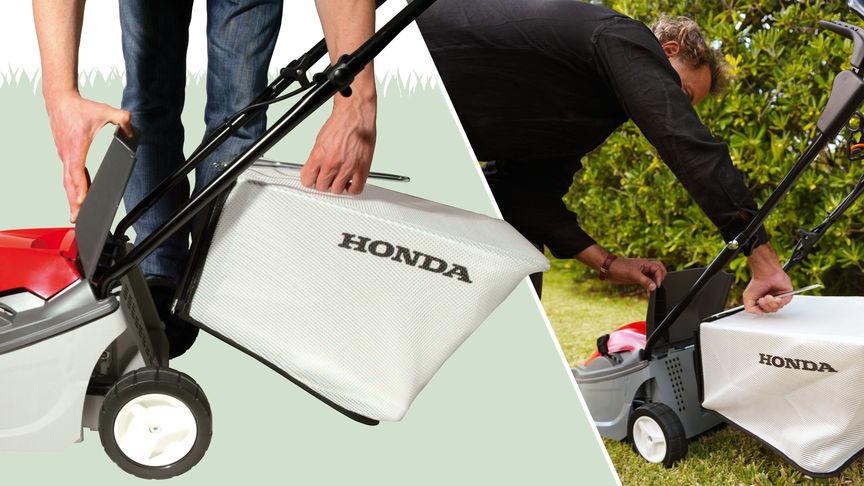 Honda HRE-Rasenmäher, Nahaufnahme von Grasfangsack, nach links zeigend, Gartenumgebung.