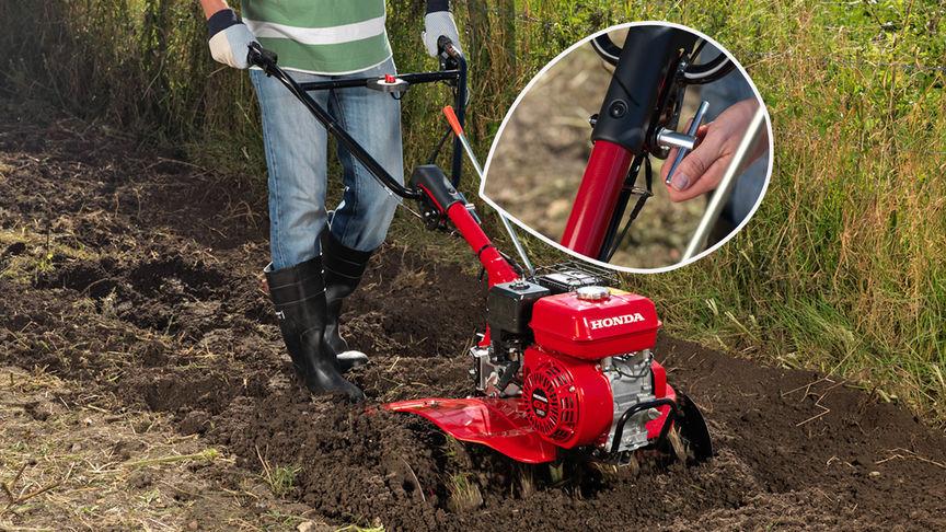 Kompakt-Motorhacke, Fokus auf dem einstellbaren Griff, Gartenumgebung.