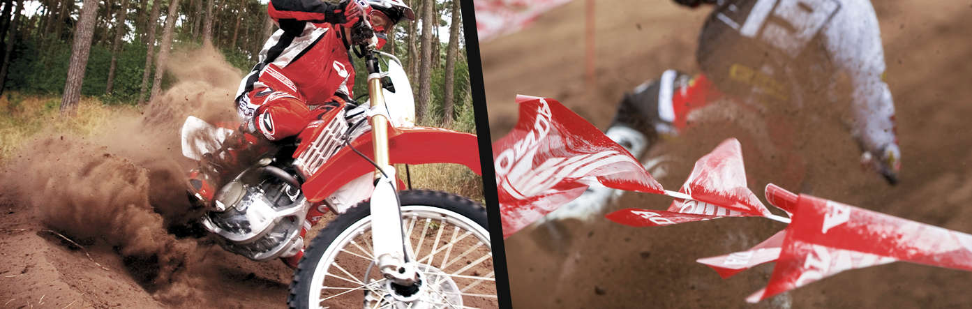 Split image showing a CRF450R with a rider leaning into a bend on a off road track to the left, and a rear view of a rider on a off road Honda motorcycle in a off road track to the right.